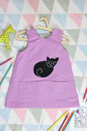 Dwustronna sukienka fioletowa z kotem