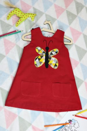 Czerwona sukienka dwustronna z motylem